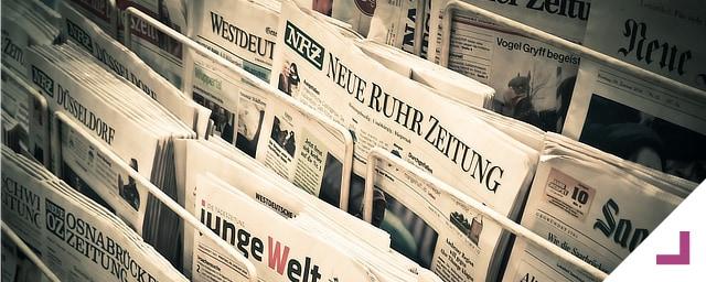 BQ Advogadas. Informação/Imprensa. Banca repleta de jornais.